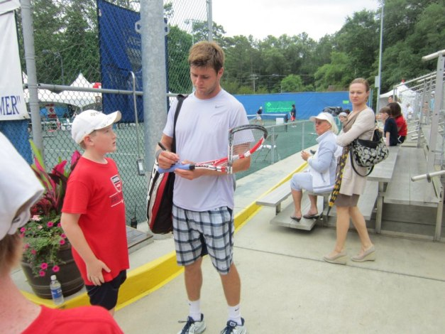 Harrison Signing Busted Racquet for the Fan who Snagged It.