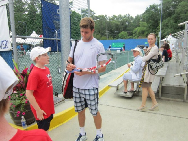 Photo Retweeted by Ben Rothenburg of Harrison Signing Busted Racquet for the Fan who Snagged It. (Now Famous)