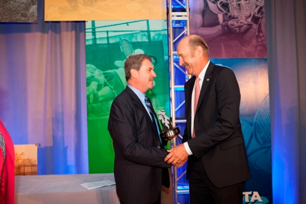 USTA CEO and President David Haggerty, left, presents Stan Smith with the  2013 President's Award.