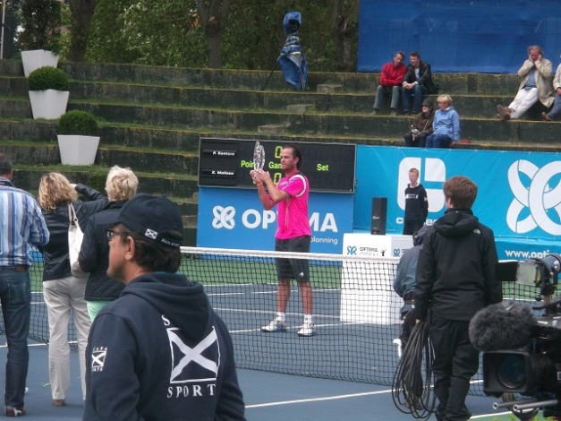 Malisse accepts his trophy