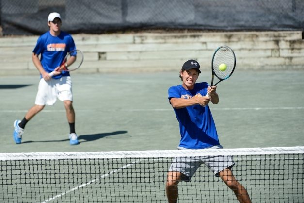 Florida's Adam Decker, background, of Panama City, Fla., and Joey Rudy, (hitting ball) of Boynton Beach, Fla., led the Gators to the final win over Auburn. Photo: USTA/TOC