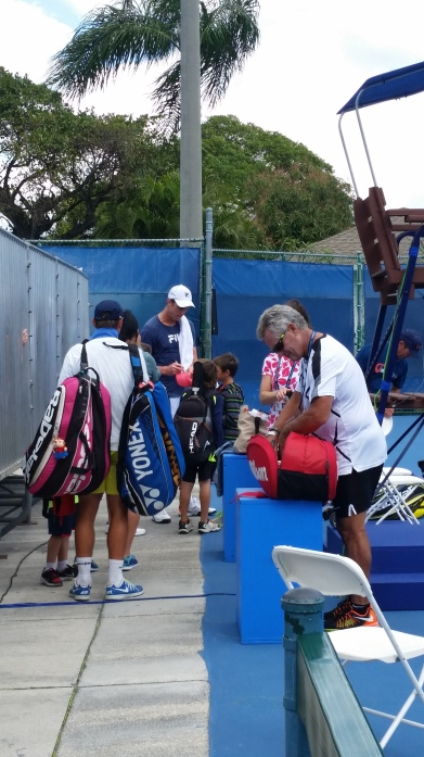 Sam Querrey signs for fans in Delray