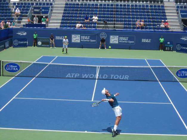 Johnson serving against Lacko